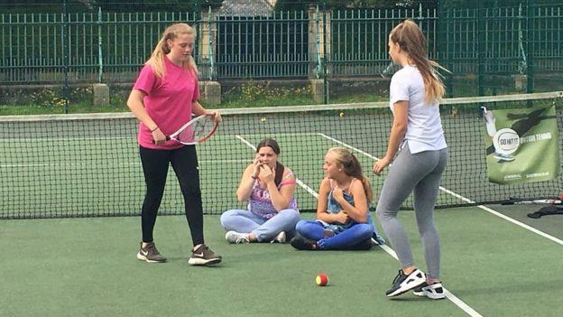 Girls on tennis court