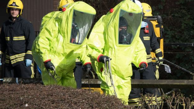 Officers in protective suits