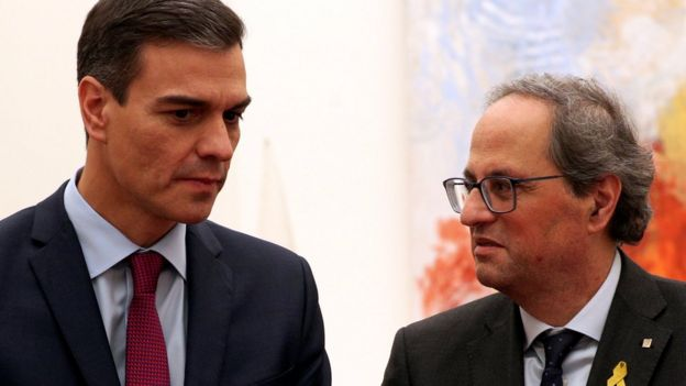 Prime Minister Pedro Sanchez and Catalan Regional President Quim Torra talk after a meeting at Palau Reial de Pedralbes in Barcelona, Spain December 20, 2018