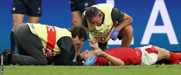 Dan Biggar receives treatment during his side's win against Fiji