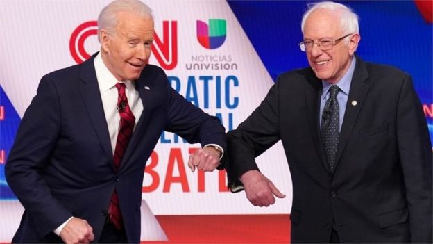 Joe Biden and Bernie Sanders elbow tap