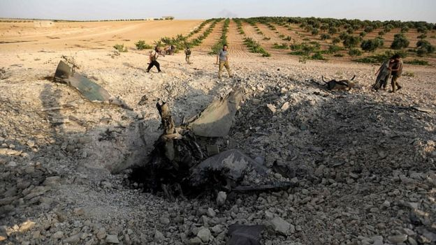 Large crater where the plane hit the ground in Idlib