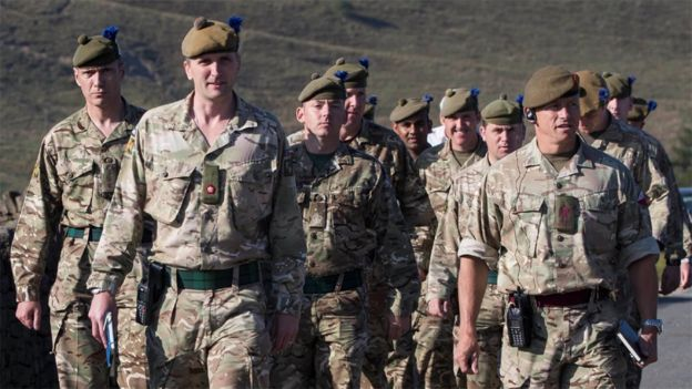 Soldiers from the Royal Regiment of Scotland arrive on Saddleworth Moor