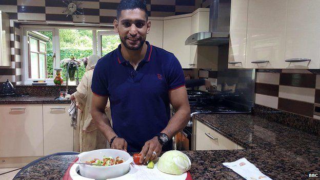 Amir Khan in his kitchen