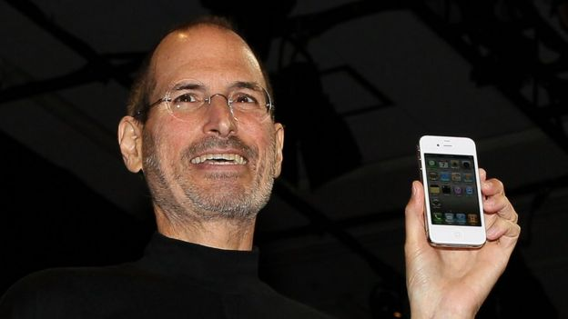 The late Apple boss Steve Jobs pictured with the fourth generation Iphone
