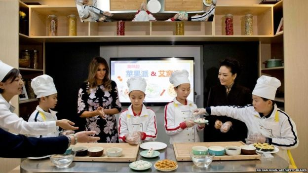 Melania Trump and Chinese First Lady Peng Liyuan watch a cooking demonstration