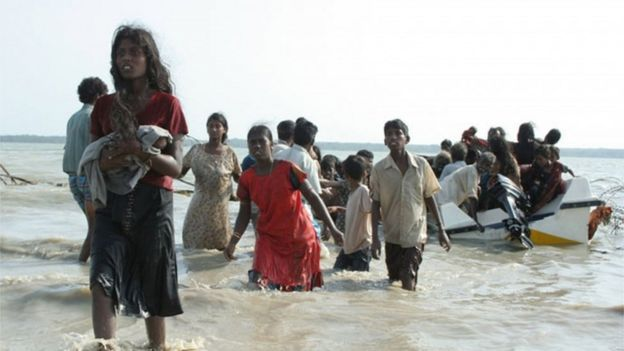 This handout picture released by the Sri Lankan Army on May 15, 2009 allegedly shows civilians who managed to escape from the last remaining Tamil Tiger rebel-held patch of coastline in the north-eastern district of Mullaittivu.