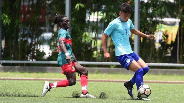 solomon playing football