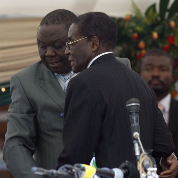 Morgan Tsvangirai leaves after being sworn in by President Robert Mugabe