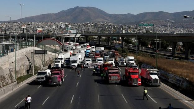 Truck drivers block the motorway known as the Mexico-Queretaro motorway, one of the principle access roads to the city, as part of a protest against the rising prices of gasoline enforced by the Mexican government in Cuatitlan Izcalli, Mexico January 4, 2017.