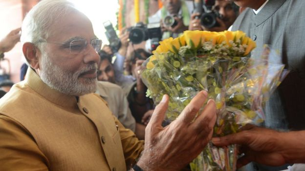 Narendran Modi receiving a bouquet