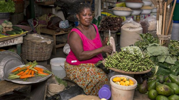 Informal worker Victoria Oaorkorat her vegetable stand at Circle market August 13, 2015 in Accra, Ghana