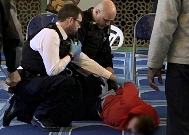 Police inside mosque blurred