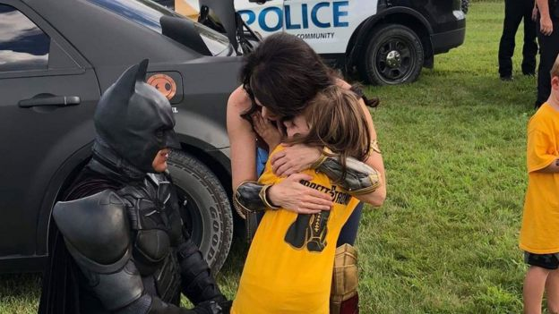 Batman, Wonder Woman and Garrett's sister at the Celebration of Life