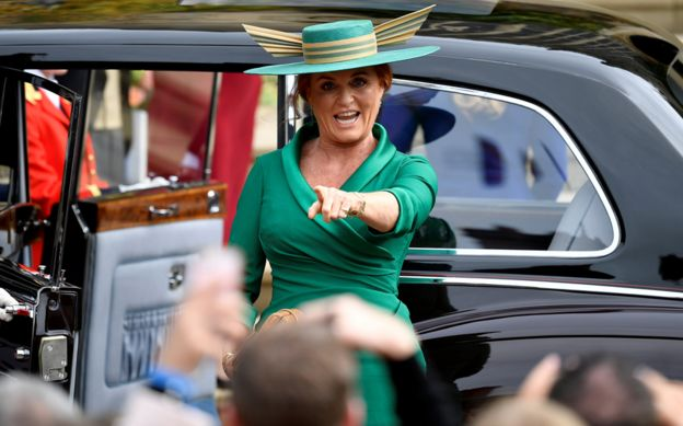 The Duchess of York points at a friend