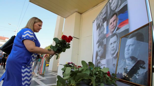 A woman places flowers to commemorate the leader of the separatist self-proclaimed Donetsk People's Republic Alexander Zakharchenko, 1 September 2018