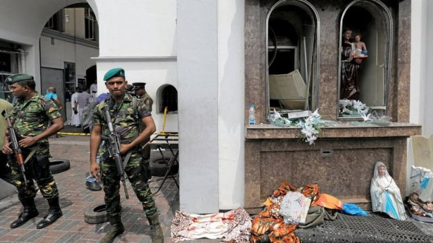 Sri Lankan soldiers stand guard outside the Kochchikade church in Colombo