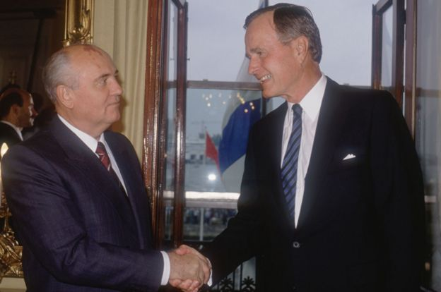 Shaking hands in Helsinki with Soviet President Mikhail Gorbachev