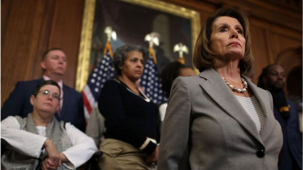 Speaker of the House Nancy Pelosi appears with federal government employees requesting an end to the partial shutdown