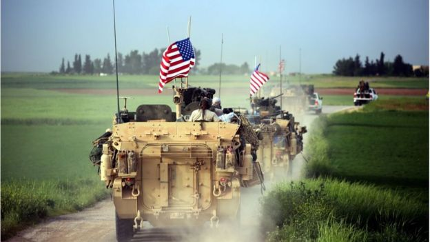 US forces, accompanied by Kurdish People's Protection Units (YPG) fighters, drive their armoured vehicles near the northern Syrian village of Darbasiyah, o­n the border with Turkey o­n April 28, 2017