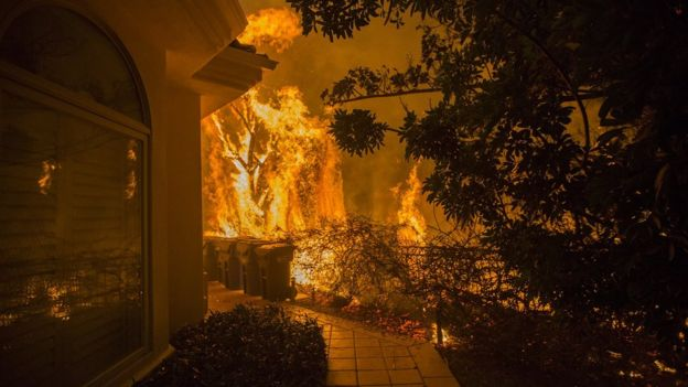 California wildfires: Nine dead and more than 150,000
