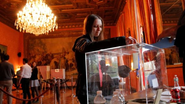 A woman votes at the French consulate in New York