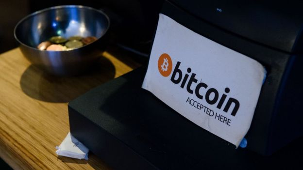 A Bitcoin sign at a cash register