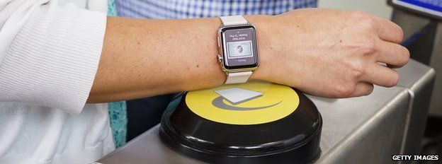 apple watch being used on London tube