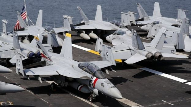 "F-18 Hornet fighter jets are seen on the flight deck of the US aircraft carrier ""USS Carl Vinson"" at the Manila Bay, Philippines, 17 February 2018"