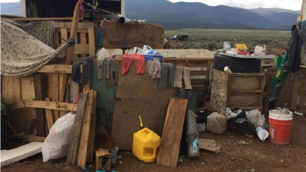 Dirty clothing and makeshift structures at the compound