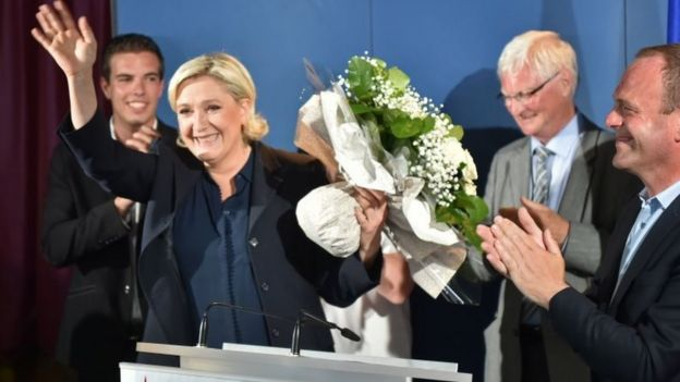 FN leader Marine Le Pen waves to her supporters in Henin-Beaumont on 18 June