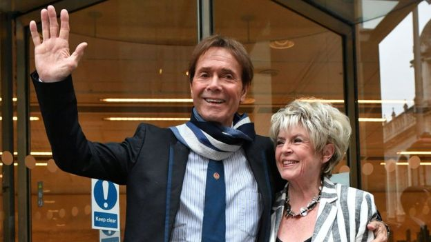 Sir Cliff Richard leaving at the High Court on 13 April 2018 with Gloria Hunniford