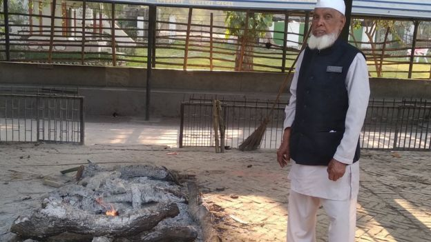 Shareef standing next to a funeral pyre