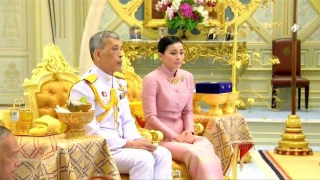 King Maha Vajiralongkorn and his consort, General Suthida Vajiralongkorn named Queen Suthida attend their wedding ceremony in Bangkok, Thailand May 1, 2019, in this screen grab taken from a video.