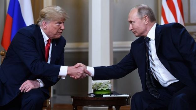 Donald Trump and Vladimir Putin shake hands