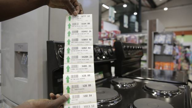 A list of new prices in Zimbabwe dollars for electrical products in a supermarket in Harare, Zimbabwe, 24 June 2019
