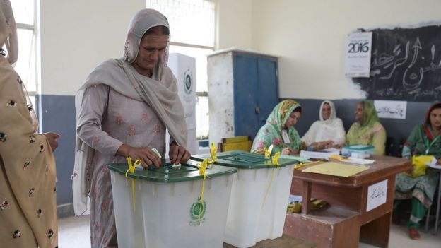 "A woman casts her vote during Pakistan""s general election"