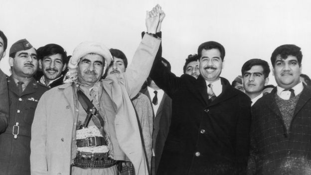 Mulla Mustafa Barzani, leader of the Kurdistan Democratic Party, holds hands with Saddam Hussein, then deputy chairman of the Revolutionary Command Council of the Iraqi Baath Party (20 March 1970)