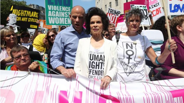Bianca Jagger (centre) joins protesters for the 'Stop Trump' Women's March