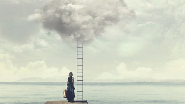 Woman looking at ladder going up to the sky