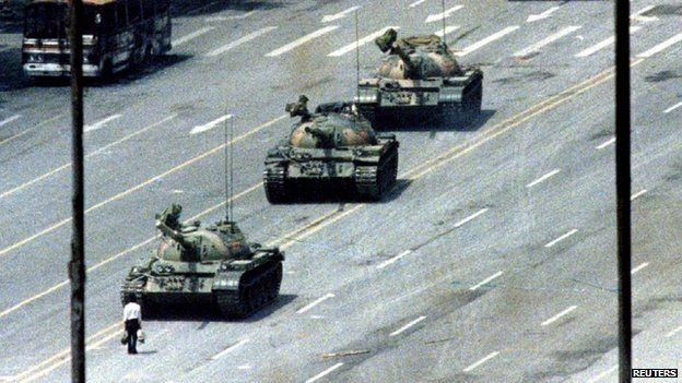 A Beijing citizen stands in front of tanks on the Avenue of Eternal Peace in this 5 June 1989 file photo during the crushing of the Tiananmen Square uprising
