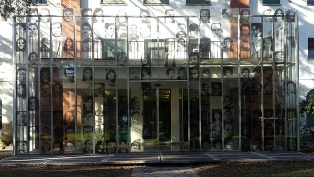 The entrance to the former naval school with pictures of people who were forcibly disappeared