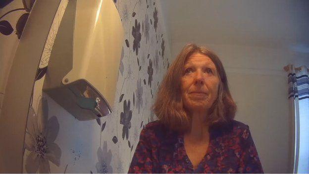 Janice Finch looking in mirror