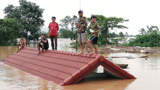 Lao villagers are stranded on a roof of a house after a dam collapsed in Attapeu province, Laos, 24 July 2018