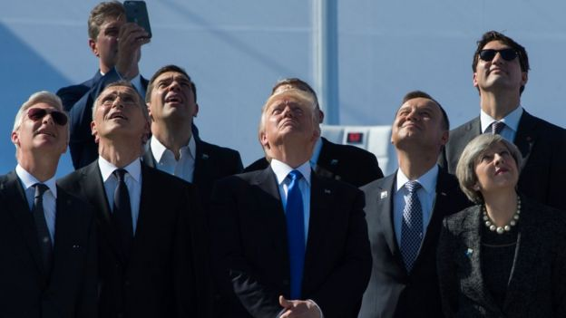 King Philippe of Belgium, NATO Secretary General Jens Stoltenberg, Greek Prime Minister Alexis Tsipras, US President Donald Trump, Poland's President Andrzej Duda, Britain's Prime Minister Theresa May and Canada's Prime Minister Justin Trudeau watch planes flying during the handover ceremony of the new headquarters of NATO (North Atlantic Treaty Organization) in Brussels, on May 25, 2017.