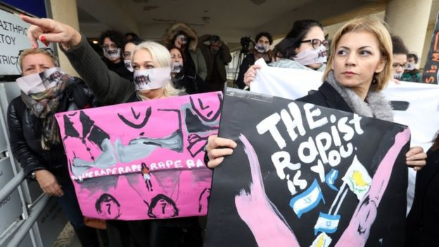 Women's right activists stage a protest outside the court