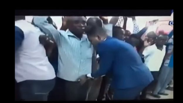 Daniel Obinim touching men's crotch