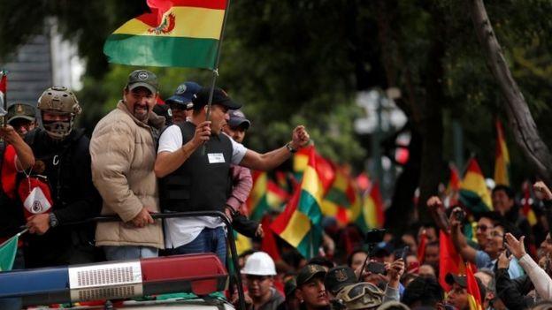 Luis Fernando Camacho greets supporters from a police car in La Paz, Bolivia, November 10, 2019.