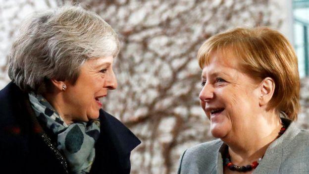 Theresa May and Angela Merkel in December