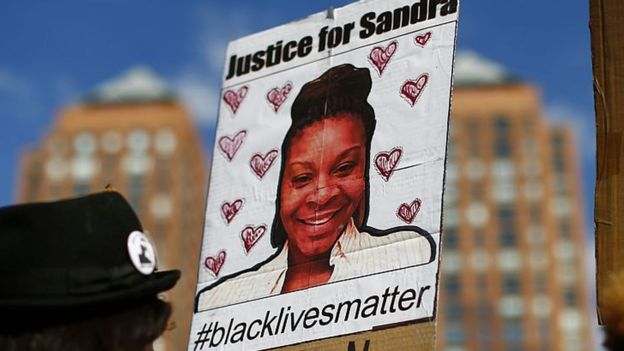 Placard with Sandra Bland's face